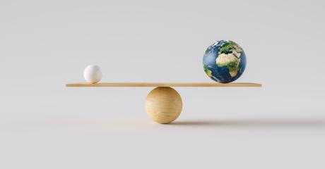 wooden scale balancing Earth ball and one small ball. Concept of harmony and balance- Stock Photo or Stock Video of rcfotostock | RC-Photo-Stock
