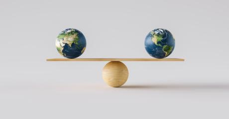 wooden scale balancing two big Earth balls. Concept of harmony and balance- Stock Photo or Stock Video of rcfotostock | RC-Photo-Stock