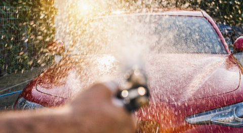 Worker Spraying foam to a red sports car with high pressure foam gun car wash at car wash- Stock Photo or Stock Video of rcfotostock | RC-Photo-Stock