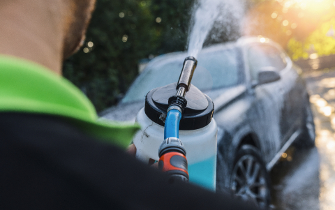 Worker Spraying foam to a SUV car with high pressure foam gun car wash at car wash : Stock Photo or Stock Video Download rcfotostock photos, images and assets rcfotostock | RC-Photo-Stock.: