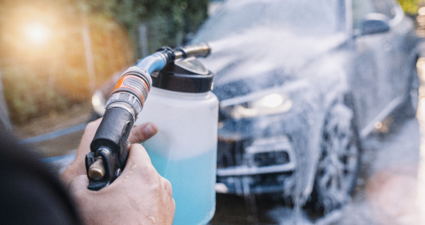 Worker Spraying foam to a SUV car with high pressure foam gun car wash at car wash- Stock Photo or Stock Video of rcfotostock | RC-Photo-Stock