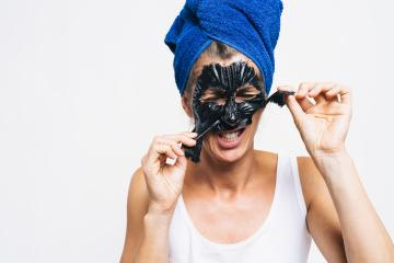 Young attractive girl takes off black facial face. with wrapped bath towel on the head in blue color : Stock Photo or Stock Video Download rcfotostock photos, images and assets rcfotostock | RC-Photo-Stock.: