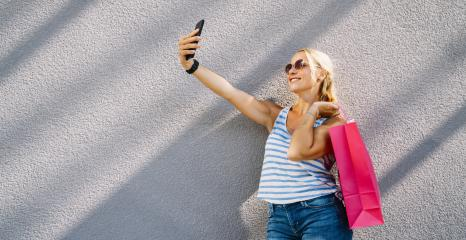 Young attractive woman taking selfie with smartphone with shopping bag after shopping. holding mobile phone and doing selfie. : Stock Photo or Stock Video Download rcfotostock photos, images and assets rcfotostock | RC-Photo-Stock.:
