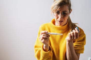 young attractive woman with glasses holding pregnancy test at home looking at positive result in shock and stress having surprise in girl unwanted maternity concept image : Stock Photo or Stock Video Download rcfotostock photos, images and assets rcfotostock | RC-Photo-Stock.: