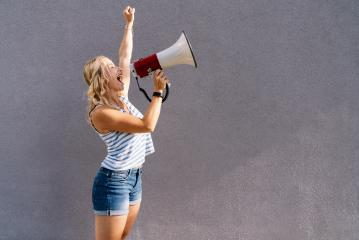 young blond woman shouting on a megaphone. copyspace for your individual text. business concept image- Stock Photo or Stock Video of rcfotostock | RC-Photo-Stock