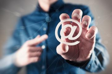 young business man holding email sign (at sign)- Stock Photo or Stock Video of rcfotostock | RC-Photo-Stock