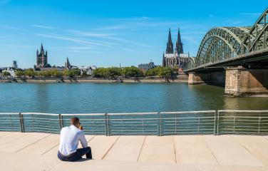 young businessman spending his time at the deutzer rhine boulevard in Cologne at summer- Stock Photo or Stock Video of rcfotostock | RC-Photo-Stock