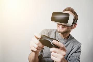 young gamer wearing Virtual Reality goggles VR Headset- Stock Photo or Stock Video of rcfotostock | RC-Photo-Stock