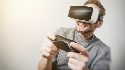 young gamer wearing Virtual Reality goggles VR Headset and play- Stock Photo or Stock Video of rcfotostock | RC-Photo-Stock