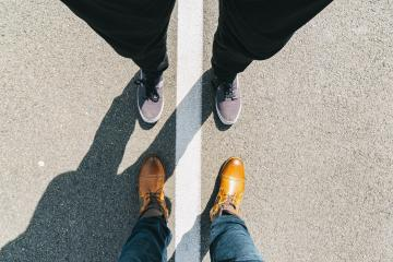 young man and a business man stands opposite on the street with white line, high angle footsie or flortrait, personal pespective from above- Stock Photo or Stock Video of rcfotostock | RC-Photo-Stock