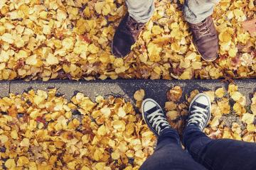 young man and a girl in sneakers stands opposite on a curbside at autumn with yellow foliage, high angle footsie or flortrait, personal pespective from above.- Stock Photo or Stock Video of rcfotostock | RC-Photo-Stock