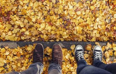 young man and his girl friend stands on a curbside at autumn, high angle footsie or flortrait, personal pespective from above.- Stock Photo or Stock Video of rcfotostock | RC-Photo-Stock