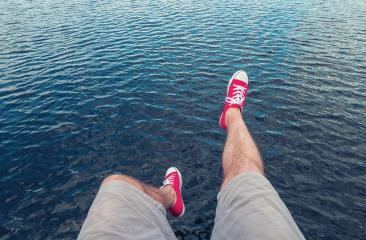 Young man in red sneakers jumps in to the ocean, Point of view shot- Stock Photo or Stock Video of rcfotostock | RC-Photo-Stock