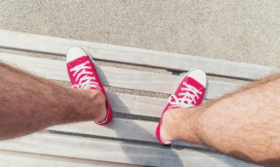 Young man in Red Sneakers sits on a bench at a summer day, Point of view shot- Stock Photo or Stock Video of rcfotostock | RC-Photo-Stock