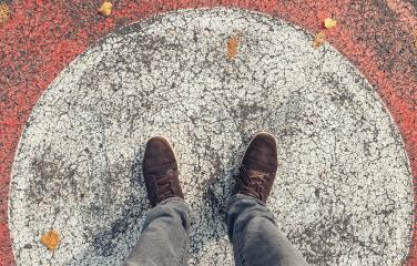 Young man in sneakers stands in a circle at the streets, personal pespective from above.- Stock Photo or Stock Video of rcfotostock | RC-Photo-Stock