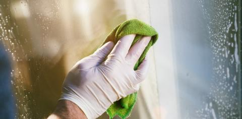 young man is using a rag and squeegee while cleaning windows. : Stock Photo or Stock Video Download rcfotostock photos, images and assets rcfotostock | RC-Photo-Stock.: