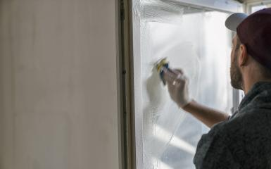 young man is using a sponge to clean a windows. professional window cleaner- Stock Photo or Stock Video of rcfotostock | RC-Photo-Stock
