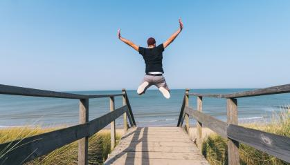 Young Man Jumps on Beach over a wooden path to the Baltic sea on a summer day : Stock Photo or Stock Video Download rcfotostock photos, images and assets rcfotostock | RC-Photo-Stock.:
