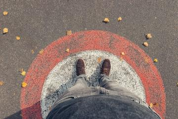 Young man stands in a circle at autumn on the streets, personal pespective from above.- Stock Photo or Stock Video of rcfotostock | RC-Photo-Stock