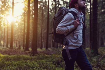 Young man walking in a forest and looking around, nature and exploration concept image : Stock Photo or Stock Video Download rcfotostock photos, images and assets rcfotostock | RC-Photo-Stock.: