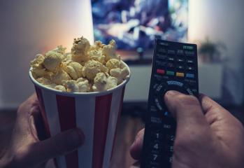 young man Watching a Movie in his living room with popcorn and remote control, Point of view shot : Stock Photo or Stock Video Download rcfotostock photos, images and assets rcfotostock | RC-Photo-Stock.: