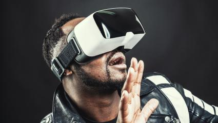 Young man wearing virtual reality googles / VR Glasses- Stock Photo or Stock Video of rcfotostock   RC-Photo-Stock