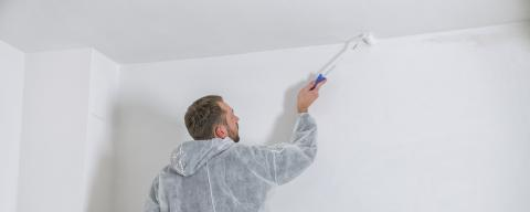 young painter working with paint roller to paint the ceiling of a room with white color. do it yourself concept image- Stock Photo or Stock Video of rcfotostock | RC-Photo-Stock