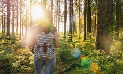 Young Traveler woman with backpack stand in forrest and enjoys nature and sunlight : Stock Photo or Stock Video Download rcfotostock photos, images and assets rcfotostock | RC-Photo-Stock.: