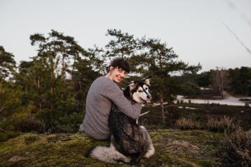 Young woman and dog are having fun and laughing. Looking at the camera. The woman and the husky enjoy the view in a beautiful landscape. Hugging at sunset. : Stock Photo or Stock Video Download rcfotostock photos, images and assets rcfotostock | RC-Photo-Stock.: