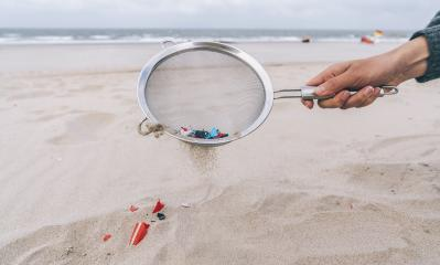 Young woman cleaning microplastics from sand on the beach, Environmental problem, pollution, ecolosystem and climate change warning concept  : Stock Photo or Stock Video Download rcfotostock photos, images and assets rcfotostock | RC-Photo-Stock.: