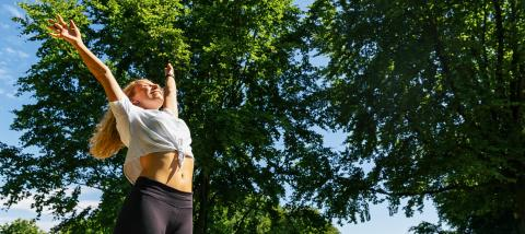 Young woman enjoying spring breeze in the park after sport. - Stock Photo or Stock Video of rcfotostock | RC-Photo-Stock
