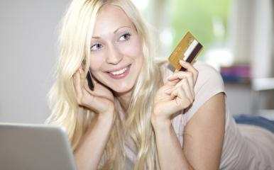 young woman holds credit card- Stock Photo or Stock Video of rcfotostock | RC-Photo-Stock