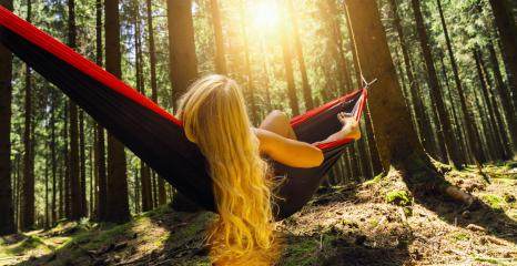 Young woman in a comfortable hammock at the forest- Stock Photo or Stock Video of rcfotostock | RC-Photo-Stock