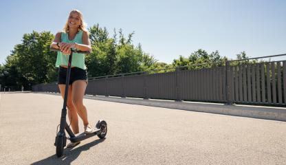 Young woman is ready to riding a black electric kick scooter at cityscape, copyspace for your individual text.- Stock Photo or Stock Video of rcfotostock | RC-Photo-Stock