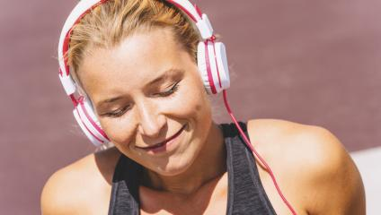 Young woman listening to music with earphones for fitness motivation. Portrait of a young woman in sportswear relaxing sitting getting inspired. : Stock Photo or Stock Video Download rcfotostock photos, images and assets rcfotostock | RC-Photo-Stock.: