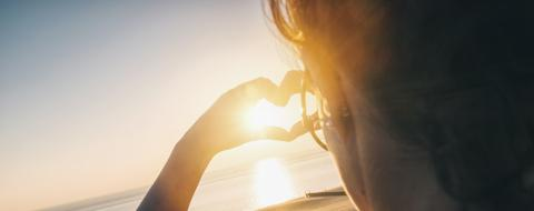 Young woman making heart with her hands at sunset on the ocean- Stock Photo or Stock Video of rcfotostock | RC-Photo-Stock