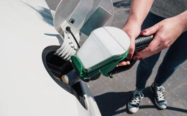Young woman refueling car tank at a fuel station- Stock Photo or Stock Video of rcfotostock | RC-Photo-Stock