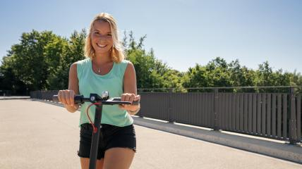 Young woman smiling ready to riding a electric scooter at cityscape, copyspace for your individual text. : Stock Photo or Stock Video Download rcfotostock photos, images and assets rcfotostock   RC-Photo-Stock.: