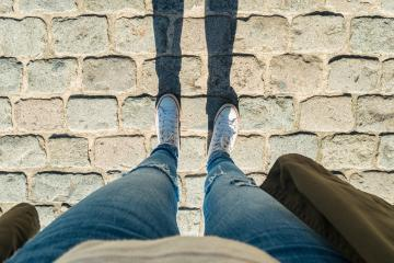 Young woman stands cobblestones, personal pespective from above.- Stock Photo or Stock Video of rcfotostock | RC-Photo-Stock