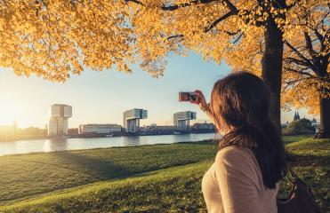 young woman takes a selfie at the rhien shore in Cologne, germany- Stock Photo or Stock Video of rcfotostock | RC-Photo-Stock