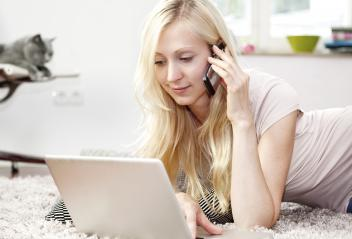 Young woman using Laptop and phone- Stock Photo or Stock Video of rcfotostock | RC-Photo-Stock