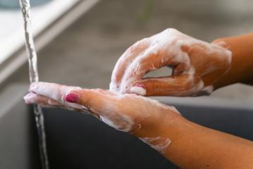 Young woman washing her hands under water with soap- Stock Photo or Stock Video of rcfotostock | RC-Photo-Stock