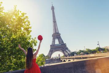 Young woman with red cap enjoying the great view on the Eiffel tower in Paris- Stock Photo or Stock Video of rcfotostock | RC-Photo-Stock