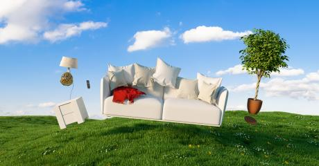 Zero Gravity Sofa hovering over a meadow with furniture and blue sky- Stock Photo or Stock Video of rcfotostock | RC-Photo-Stock