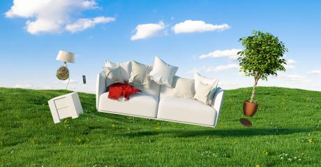 Zero Gravity Sofa hovering over a meadow with furniture and cloudy sky- Stock Photo or Stock Video of rcfotostock | RC-Photo-Stock