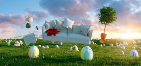 Zero Gravity Sofa hovering over many colorful painted Easter eggs on a meadow with furniture at sunset- Stock Photo or Stock Video of rcfotostock | RC-Photo-Stock