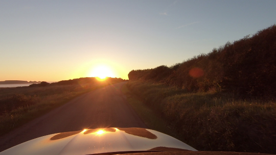 car on land road on a sunny afternoon at sunset, first person pov shot- Stock Photo or Stock Video of rcfotostock | RC-Photo-Stock