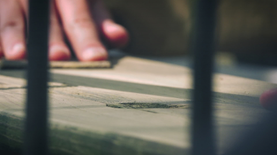 Close up of adult man caring about his outdoor furniture - handmade grinding with abrasive paper. Close up shot. - Stock Photo or Stock Video of rcfotostock | RC-Photo-Stock