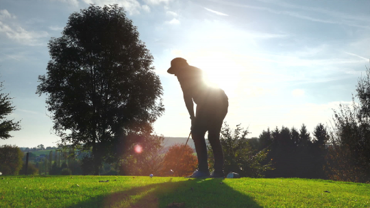 Golf Player plays golf on a beautiful summer morning. wide angle Lens flare Back lite shot - Stock Photo or Stock Video of rcfotostock | RC-Photo-Stock