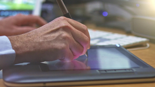 Graphic Designer working with digital Drawing tablet and Pen on a computer. Smooth tracking shot with nice backlit lensflare.- Stock Photo or Stock Video of rcfotostock | RC-Photo-Stock